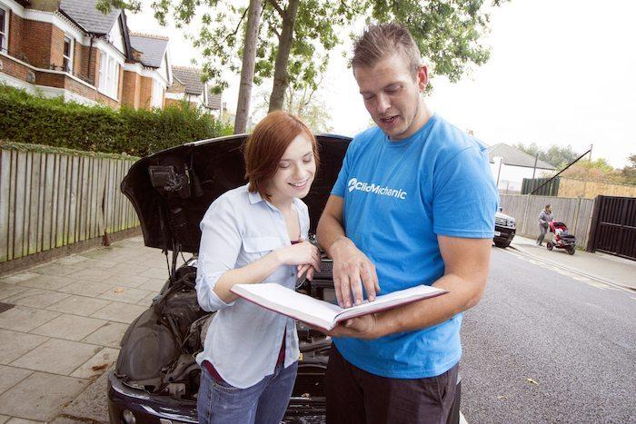 ClickMechanic Employee working with customer